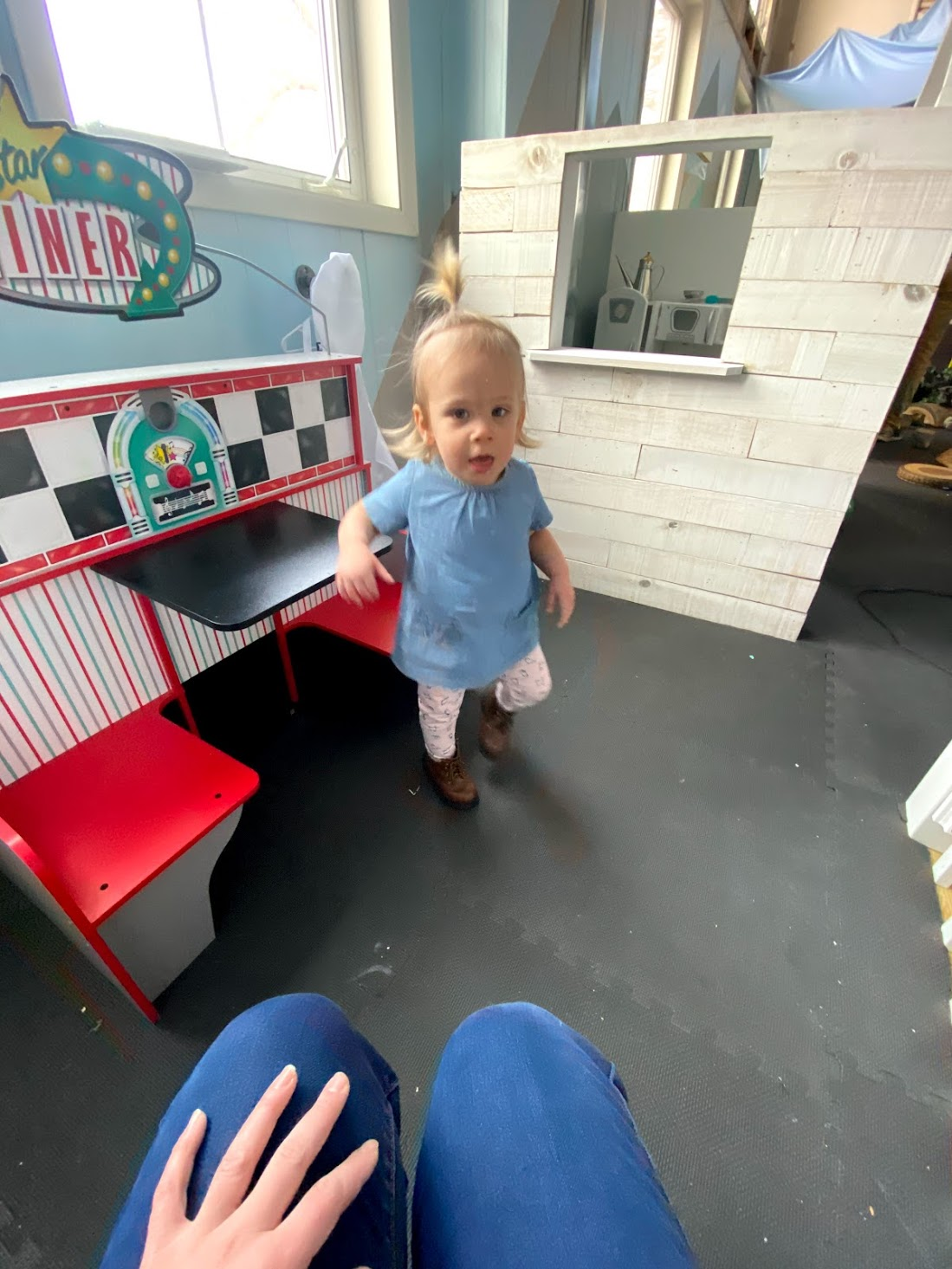 toddler playing at the diner in kid city